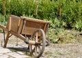 Wooden wheel borrow empty in the garden Royalty Free Stock Photography