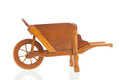 Wooden wheelbarrow classic isolated over white background Stock Photography