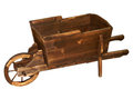Wooden wheelbarrow homemade on white Stock Images