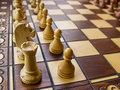 Wooden white and brown chessboard Stock Photo