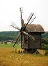 Wooden wind mill Stock Photo