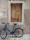 WOODEN WINDOW AND BLUE BICYCLE, ROVINJ, CROATIA Royalty Free Stock Photo