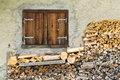 Wooden window with wood pile Royalty Free Stock Photo