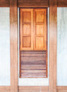 Wooden window on the concrete wall in the classical house Royalty Free Stock Images