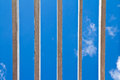 Wooden window grilles and blue sky Stock Images
