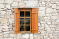Wooden window and shutters in stone wall natural Royalty Free Stock Photo