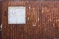 Wooden window in vintage rusty grunge metal plate Royalty Free Stock Photo