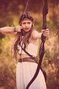 Woodland hunter woman with bow and arrow Royalty Free Stock Photo