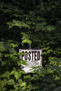 Woodland posted sign a in a rural wooded area states private property and no trespassing incidences of people posting their land Royalty Free Stock Photography