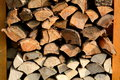 Woodpile fresh stacked firewood from different kinds of wood Stock Photo