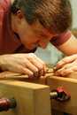 Woodworker Making Close Measurement Royalty Free Stock Photo