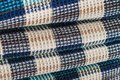 Wool fabric for a plaid with a pattern consisting of colored cells