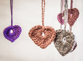 Wool hearts hanging on the white background Stock Photo
