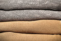Wool jumpers beige and grey folded as a background Royalty Free Stock Photos