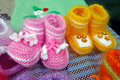 Wool knitted baby shoes two pairs of woolen Royalty Free Stock Images