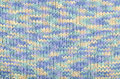 Wool sweater pattern as a background close up on blue and white degrade knit texture fabric Stock Photo