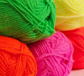 Wool threads close up multicolored rolled into balls in the shop closeup Stock Image