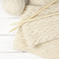 Woolen knitting on wood Royalty Free Stock Photo