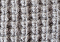 Woolen texture macro shot of gray knitted Royalty Free Stock Photos