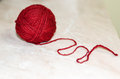 Woolen yarn close up of red on beige background Royalty Free Stock Image