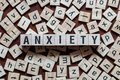 stock image of  The word of ANXIETY on building blocks concept