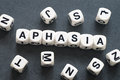 Word aphasia on toy cubes