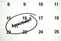 Word appointment circled on calendar the is written in black ink and a white montly page Royalty Free Stock Photos
