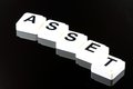 The word asset a term used for business in finance and stock market trading spelled out with white tiles on black background Stock Image