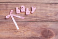 Word baby in wood background Stock Images