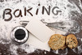 Word baking written in flour and cooking utensils on wooden tabl white a table Stock Photo