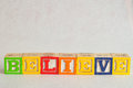 The word believe spelled with colorful alphabet blocks Royalty Free Stock Photo