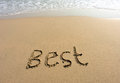 Word best drawn on the beach and sea wate Stock Photography