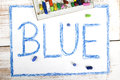Word BLUE written in blue crayon Royalty Free Stock Photo