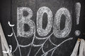 Word Boo drawn on black drawing board Royalty Free Stock Photo