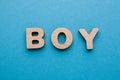 Word Boy on blue background