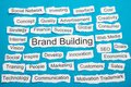 Word brand building on piece of torn paper Royalty Free Stock Photo