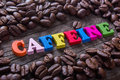 Word caffeine and coffee beans Royalty Free Stock Photo