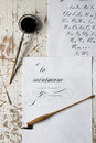 Word Calligraphy written on paper, with calligraphy tools in background Royalty Free Stock Photo