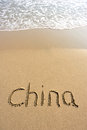 Word china drawn on the beach and sea wate Stock Photo