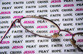 Word for christian print and eyeglass put on the paper Royalty Free Stock Image