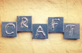 The word craft made from metal letters on an old vintage paper background Stock Photo