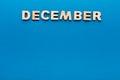 Word December on blue background