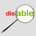 Word disable under magnifier emblem isolated on grey Royalty Free Stock Photography
