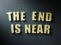 The word the end is near on paper background in cut out letters Royalty Free Stock Photography