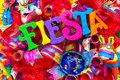The word `fiesta` written in colorful foam letters on multicolored mash decorated with glitter and small sombrero Royalty Free Stock Photo