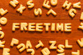 The word freetime written with cracker Royalty Free Stock Photo