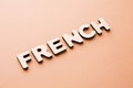 Word French on beige background Royalty Free Stock Photo