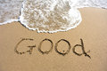Word good drawn on the beach and sea wate Royalty Free Stock Image