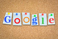 Word Google on cork billboard with memo papers and pins Royalty Free Stock Photo