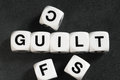 Word guilt on toy cubes Royalty Free Stock Photo
